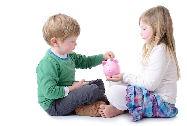 kids savings in piggy bank
